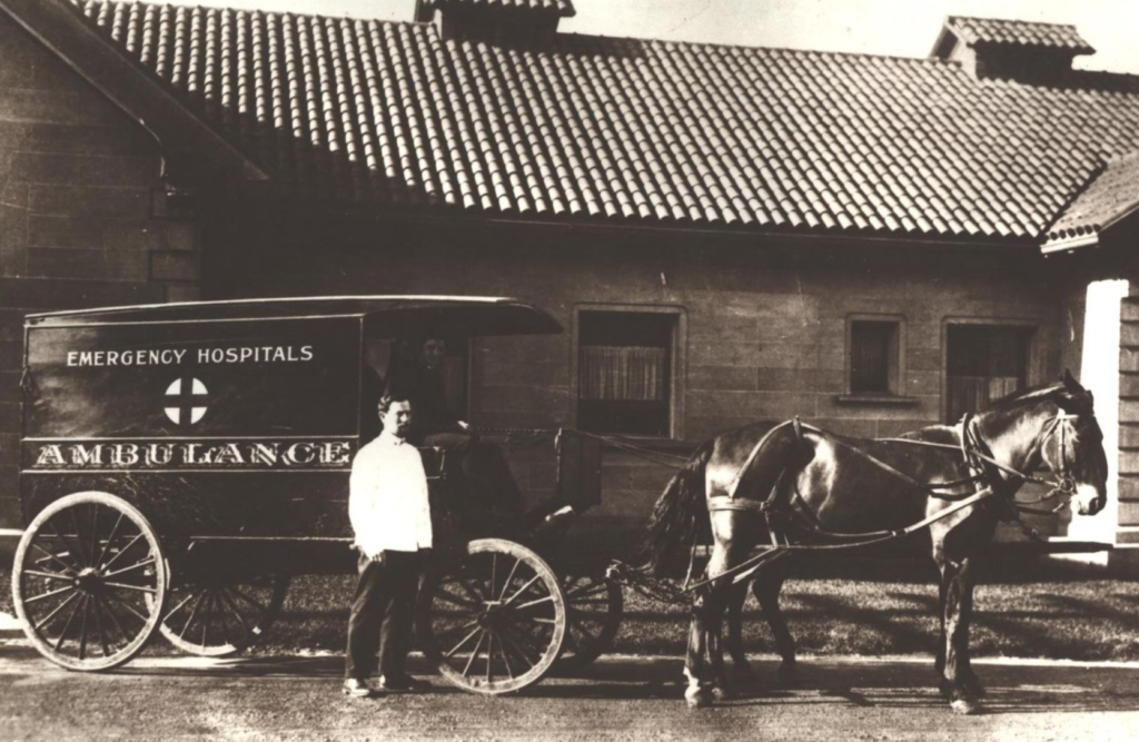 An Ambulance in front of the hospital when it first opened.
