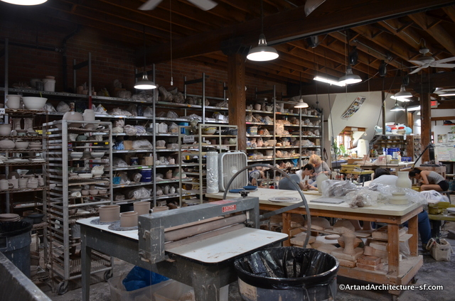 Much of the work at Pewabic is done on potters wheels, the bags on the shelves hold the many different types of clays that are used