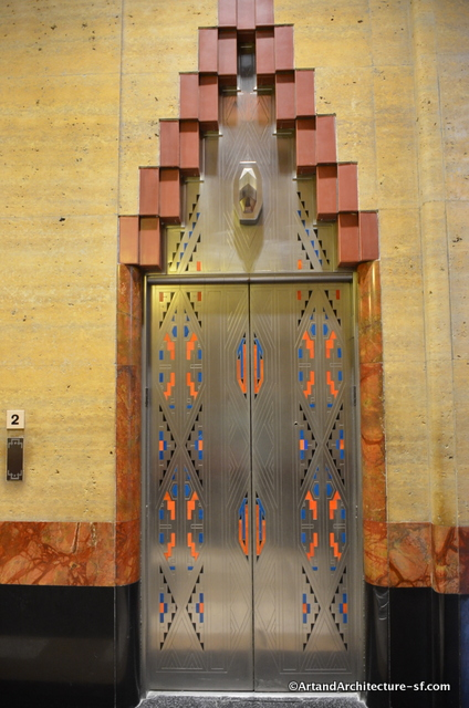 The elevator doors are etched and painted